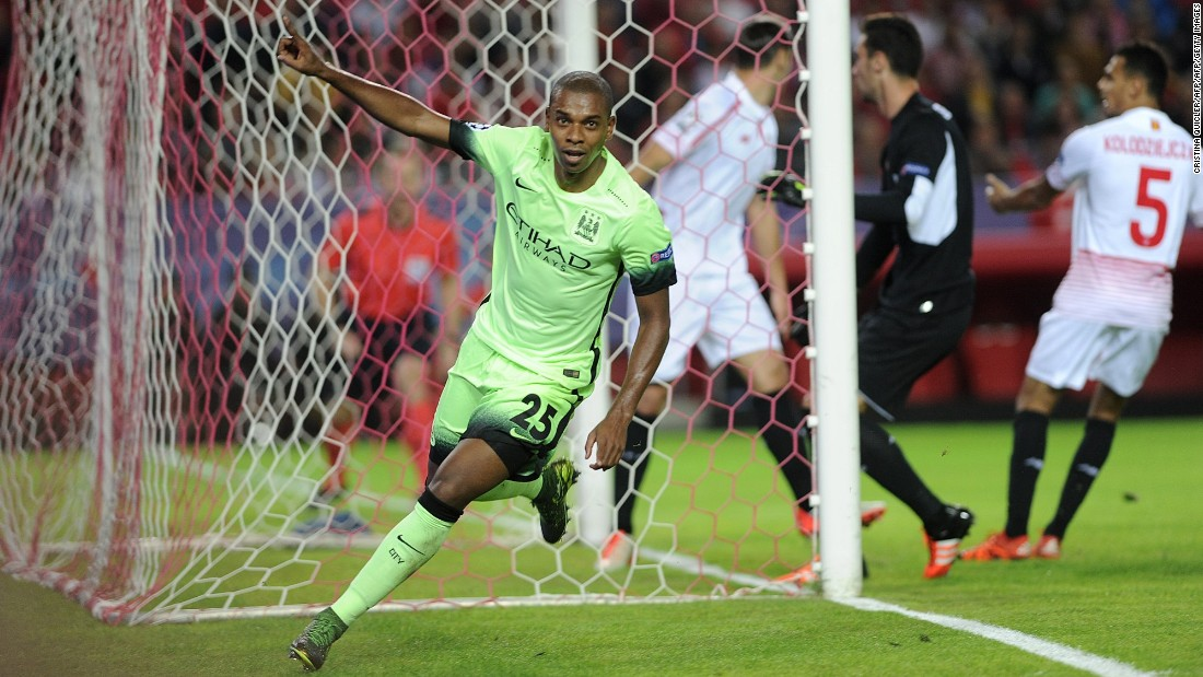Manchester City qualified for the knockout stage, winning 3-1 at Sevilla. Brazilian midfielder Fernandinho celebrates after scoring the English team's second goal, having set up the opener for Raheem Sterling.