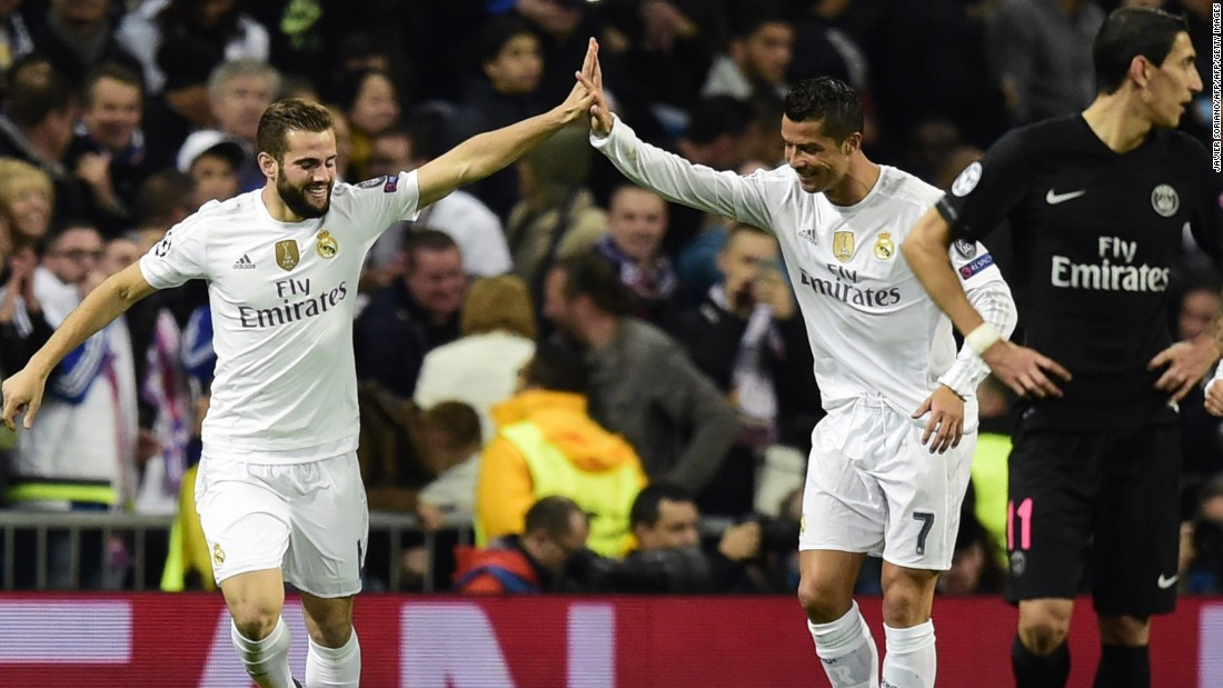 Nacho Fernandez (left) celebrates with Cristiano Ronaldo after the substitute defender's goal gives Real Madrid a 1-0 win over Paris Saint-Germain, putting the Spanish team into the last 16 of the European Champions League.
