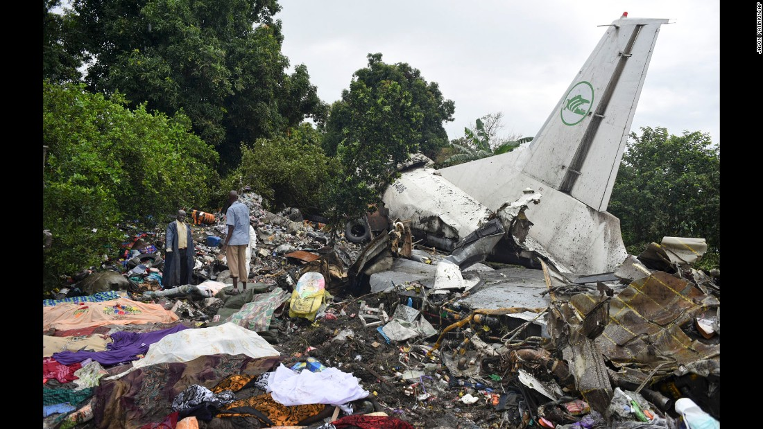 Responders pick through the wreckage of a cargo plane that crashed Wednesday, November 4, in Juba, South Sudan. The Russian-built Antonov-12 transport plane crashed shortly after takeoff, a South Sudanese official said. Three people survived, including an infant.
