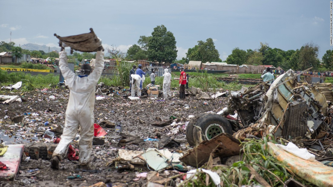 People work at the crash site near the White Nile River.