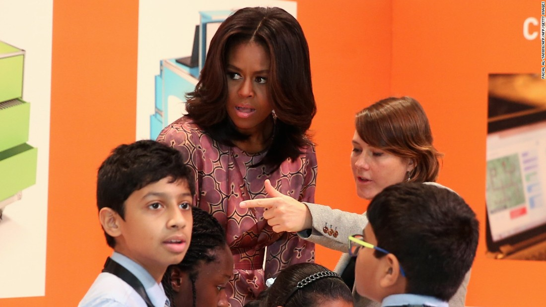 Obama speaks with schoolchildren in Doha on November 4.