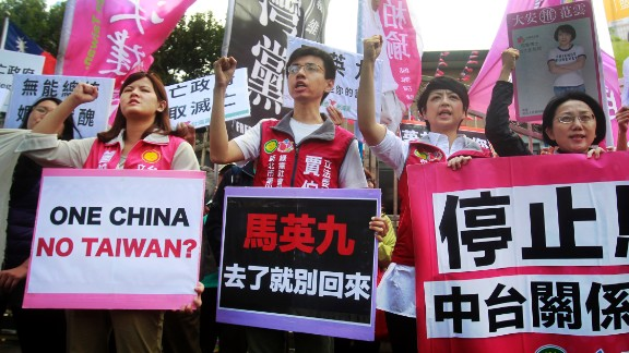 Protesters shout slogans with placards opposing the planned meeting of Taiwan