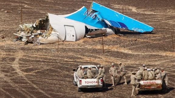 Members of the Egyptian military approach the wreckage of a Russian passenger plane Sunday, November 1, in Hassana, Egypt. The plane crashed the day before, killing all 224 people on board. ISIS claimed responsibility for downing the plane, but the group