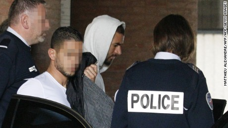 Benzema (pictured wearing hood) risks missing out on next year's European Championship finals in France.