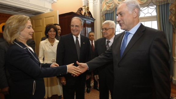 Clinton shakes hands with Netanyahu alongside Abbas and U.S. envoy George Mitchell at the U.S. State Department in Washington on September 2, 2010.
