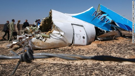 Image #: 40538776    EGYPT. NOVEMBER 1, 2015. Russia's Emergency Situations Minister Vladimir Puchkov (4th L background) at the site where a Russian aircraft crashed in Egypt's Sinai Peninsula near El Arish city. Kogalymavia Airbus A321 came down in central Sinai as it traveled from Sharm el-Sheikh to St Petersburg, killing all 217 passengers and 7 crew members on board. Maxim Grigoryev/TASS     ITAR-TASS /Landov