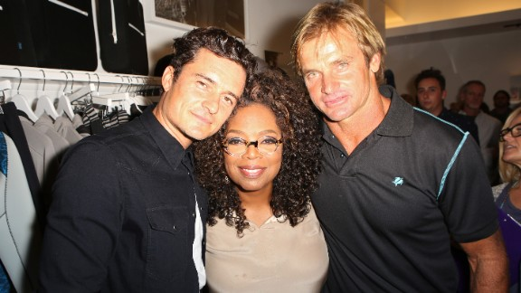 Oprah has lent her support to a number of ventures. Here she is with actor Orlando Bloom, left, and pro surfer Laird Hamilton at the launch of Hamilton's clothing line on October 22, 2015 in Santa Monica, California.
