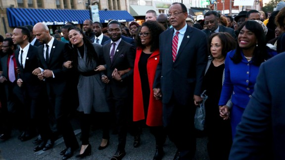 """Oprah joined members of the cast of """"Selma"""" to walk down Broad St. towards the Edmund Pettus Bridge on January 18, 2015, in Selma, Alabama. Thousands of participants attended the event in honor of Rev. Martin Luther King Jr., who led nonviolent protestors on a march from Selma to the state capitol in 1955."""