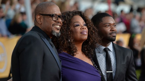 As her clout grows in Hollywood, Oprah has become a regular on the awards-show circuit. Actors Forest Whitaker and David Oyelowo join her for the 20th Annual Screen Actors Guild Awards on January 18, 2014, in Los Angeles.