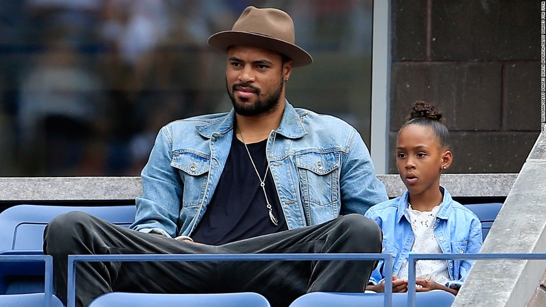 Bosh credits fellow big man Tyson Chandler of the Phoenix Suns for sparking his interest in fashion. Chandler, who is 7-foot 1-inch tall, sits with his daughter Sacha-Marie at the U.S. Open tennis tournament.