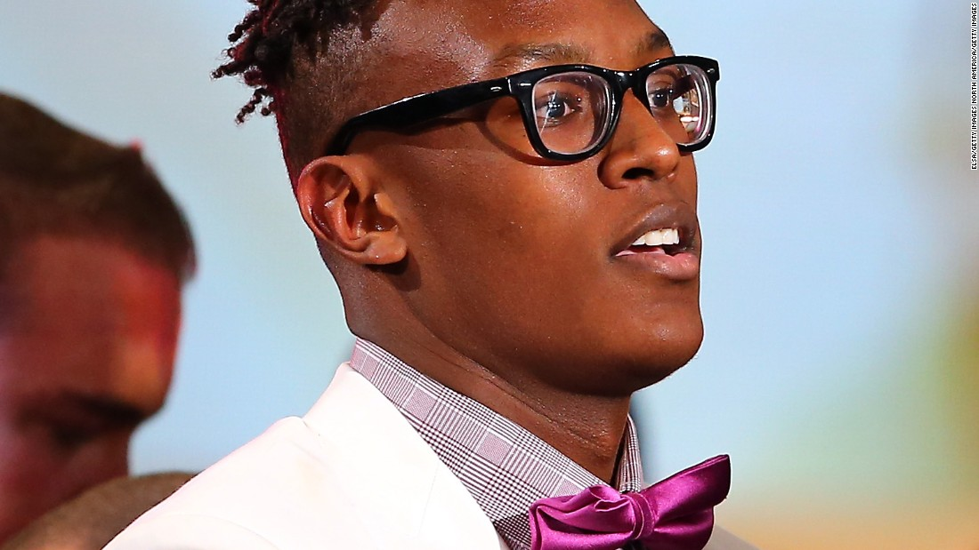 Bow tie or no bow tie? Myles Turner flaunts his violet neck accessory after being selected 11th overall by the Indiana Pacers in the first round of the 2015 draft.