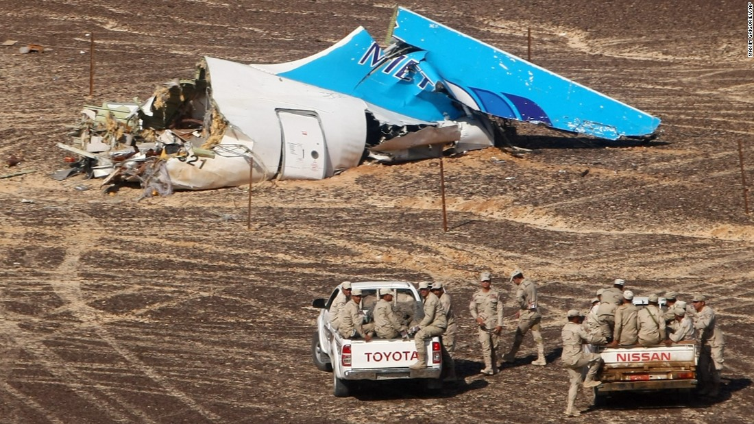 "Members of the Egyptian military approach the wreckage of a Russian passenger plane Sunday, November 1, in Hassana, Egypt. <a href=""http://www.cnn.com/2015/10/31/world/gallery/russian-plane-crash/index.html"" target=""_blank"">The plane crashed</a> the day before, killing all 224 people on board. International investigators are trying to determine why the plane went down."