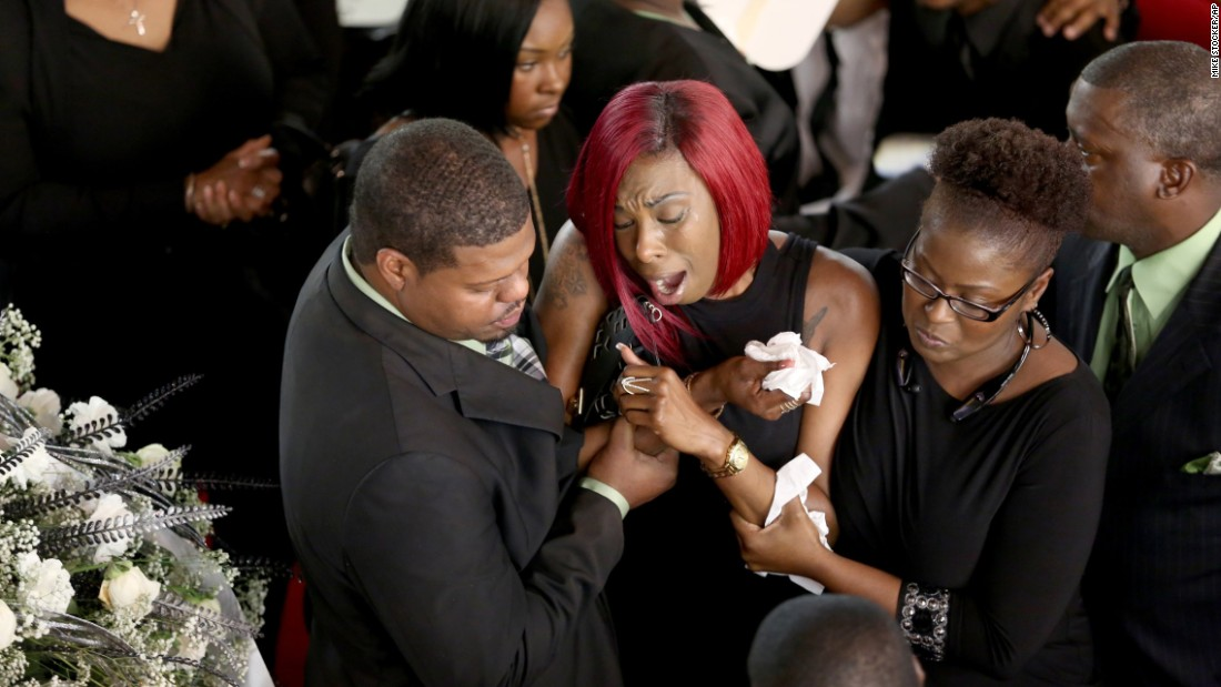 "A woman cries during Corey Jones' funeral service, which was held Saturday, October 31, in West Palm Beach, Florida. Jones, 31, <a href=""http://www.cnn.com/2015/10/20/us/florida-officer-shooting/index.html"" target=""_blank"">was fatally shot by a plainclothes police officer</a> as he waited for a tow truck for his broken-down vehicle."