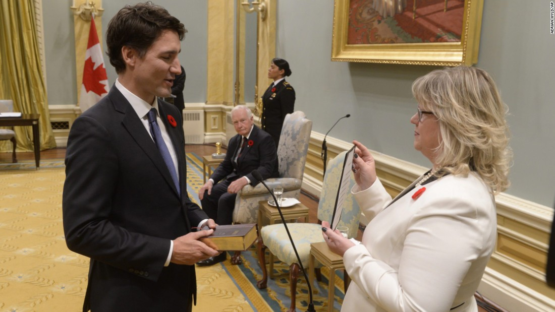 "Canada's new Prime Minister, <a href=""http://www.cnn.com/2015/10/20/world/gallery/justin-trudeau-canada-prime-minister/index.html"" target=""_blank"">Justin Trudeau</a>, takes the oath of office as he is sworn into office at Rideau Hall in Ottawa on Wednesday, November 4. Trudeau, 43, is the second-youngest Prime Minister in Canadian history."