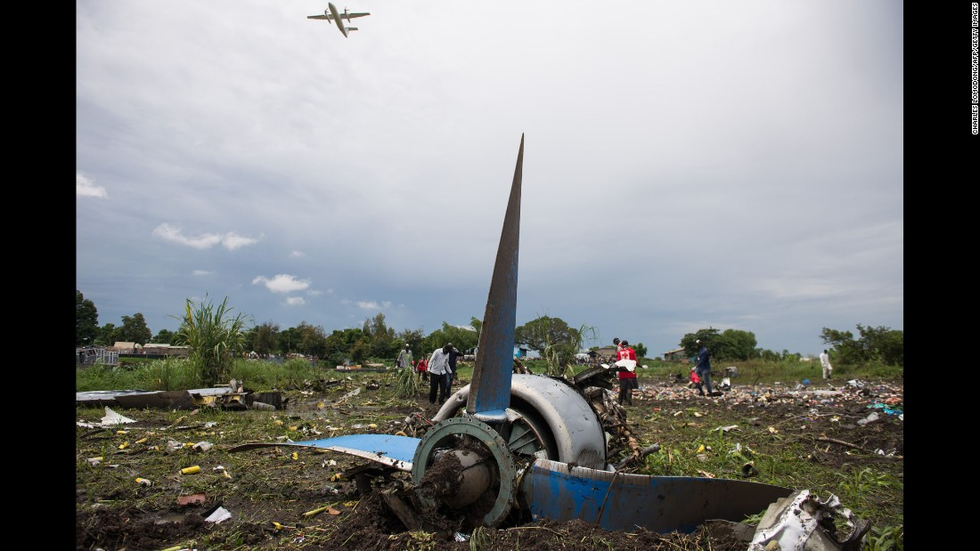 "Responders pick through the wreckage of a cargo plane that <a href=""http://www.cnn.com/2015/11/04/world/south-sudan-plane-crash/"" target=""_blank"">crashed shortly after takeoff</a> Wednesday, November 4, in Juba, South Sudan. Ateny Wek Ateny, a press secretary in the South Sudan President's office, said 18 people were aboard the flight: 12 South Sudanese passengers and six crew members made up of five Armenians and one Russian. Three people survived: two South Sudanese passengers and an infant boy less than a year old, Ateny said."