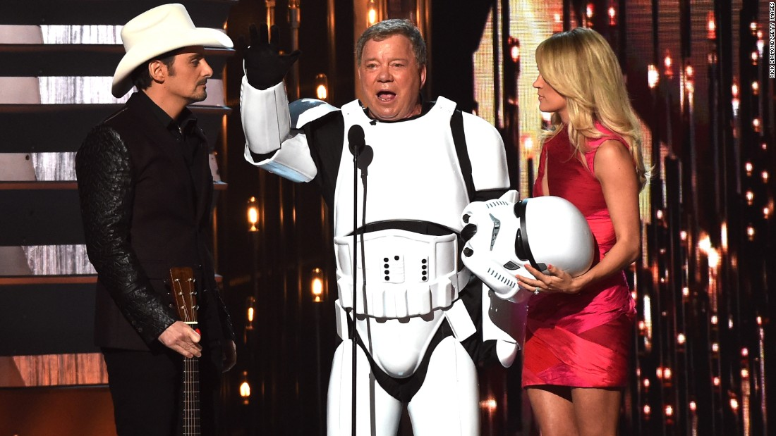 "Actor William Shatner, flanked by country singers Brad Paisley and Carrie Underwood, wears a ""Star Wars"" Stormtrooper costume during the CMA Awards in Nashville, Tennessee, on Wednesday, November 4. <a href=""http://www.cnn.com/2015/11/05/entertainment/cma-awards-2015-chris-stapleton-miranda-lambert-billboard-feat/index.html"" target=""_blank"">See the best and worst moments from the show</a>"