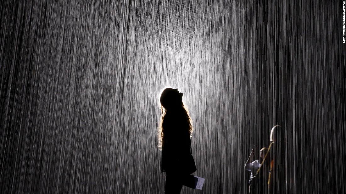 "People walk through the <a href=""http://www.lacma.org/rainroom#landing"" target=""_blank"">Rain Room</a> at the Los Angeles County Museum of Art on Friday, October 30. The installation, created by London-based arts collective Random International, uses 528 gallons of recycled water. The rain pauses wherever a body is detected."