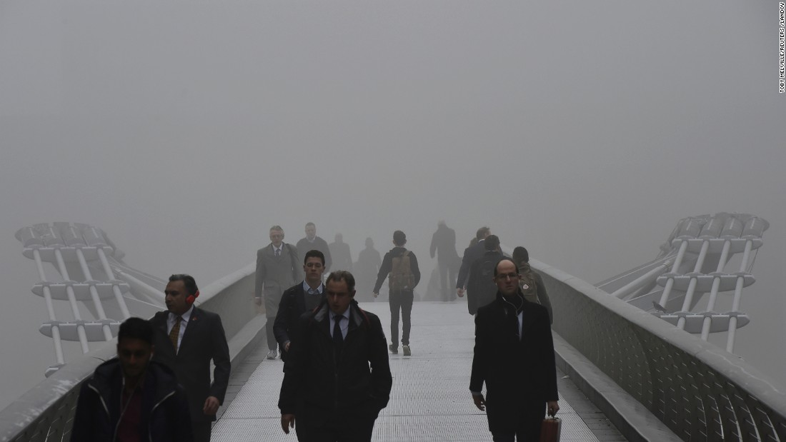 "People cross the Millennium Bridge in London during a misty morning on Monday, November 2. <a href=""http://www.cnn.com/2015/11/02/travel/gallery/foggy-london-europe/"" target=""_blank"">See more photos of Europe shrouded in mist</a>"