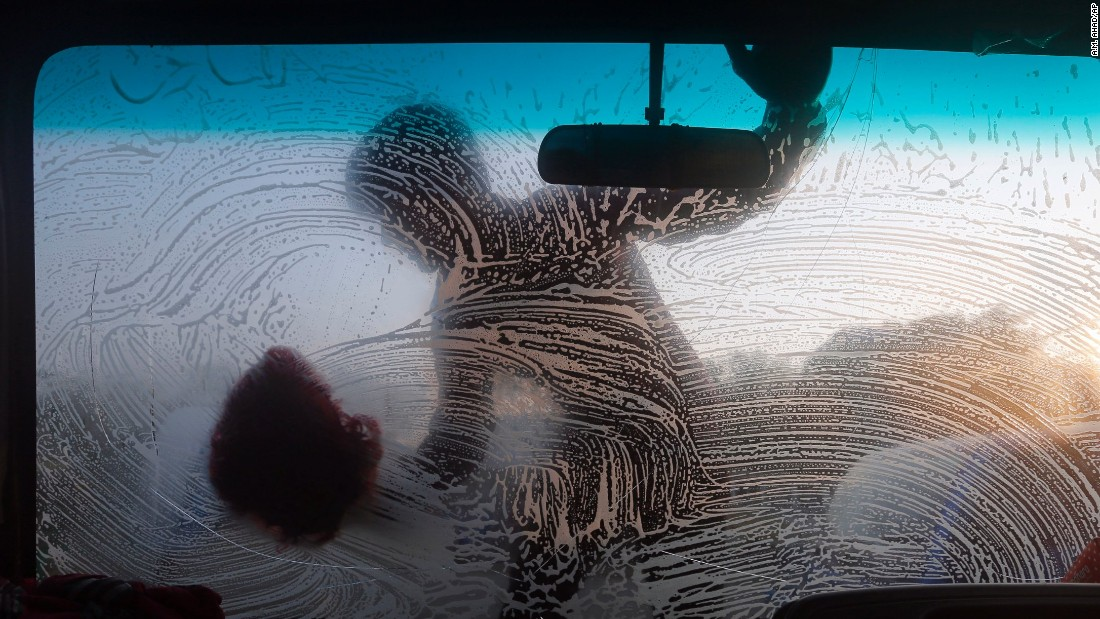 A boy cleans the windshield of a vehicle in Dhaka, Bangladesh, on Wednesday, November 4.