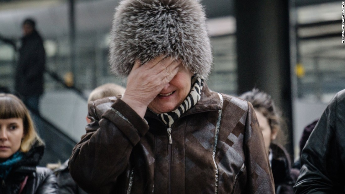 "A woman in St. Petersburg, Russia, cries near a makeshift memorial set up for the Metrojet plane crash victims on Sunday, November 1. <a href=""http://www.cnn.com/2015/10/31/world/gallery/russian-plane-crash/index.html"" target=""_blank"">Metrojet Flight 9268</a> went down over Egypt's Sinai Peninsula on Saturday, October 31."