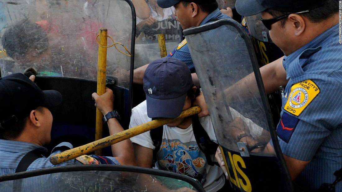 Protesters clash with police during a rally in Manila, Philippines, on Wednesday, November 4. The rally was held in front of the hotel where the Asia-Pacific Economic Cooperation was holding a climate change symposium. The protesters claimed that APEC is missing the point on climate change and its solutions.