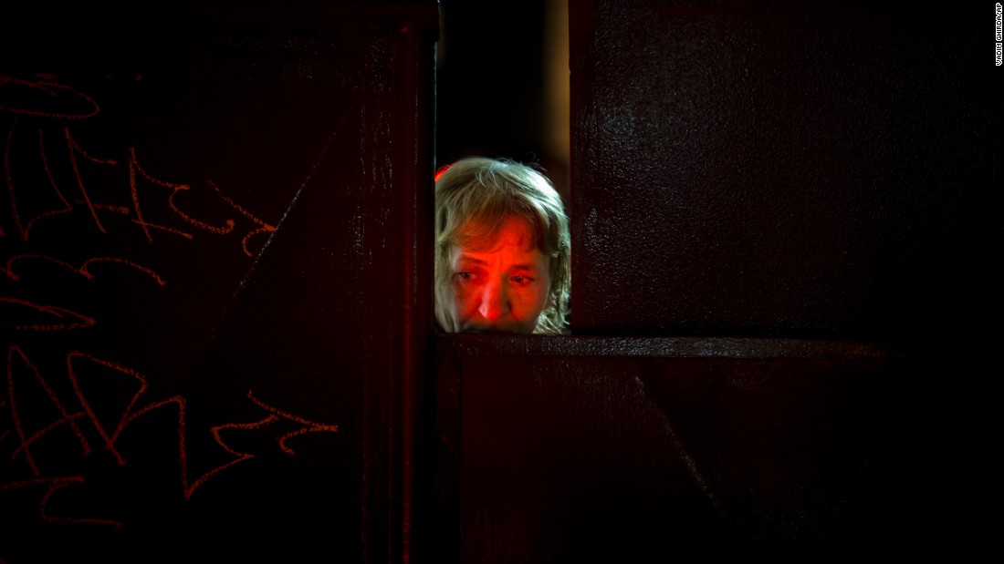 "A woman's face is illuminated by candles placed outside the Colectiv nightclub as she looks out from a metal gate leading to the club in Bucharest, Romania, on Monday, November 2. <a href=""http://www.cnn.com/2015/10/31/world/bucharest-romania-nightclub-fire/index.html"" target=""_blank"">A fire that may have been sparked by pyrotechnics</a> quickly erupted with dark, blinding smoke on Friday, October 30, killing at least 32 people, authorities said."