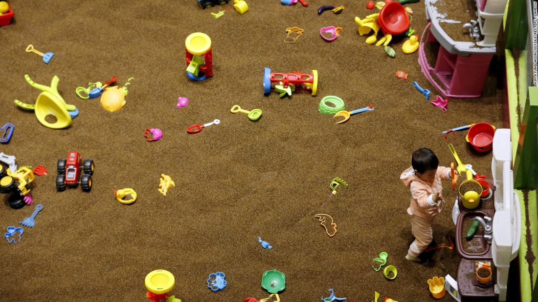 A 2-year-old girl plays at an indoor playground in Beijing on Friday, October 30.