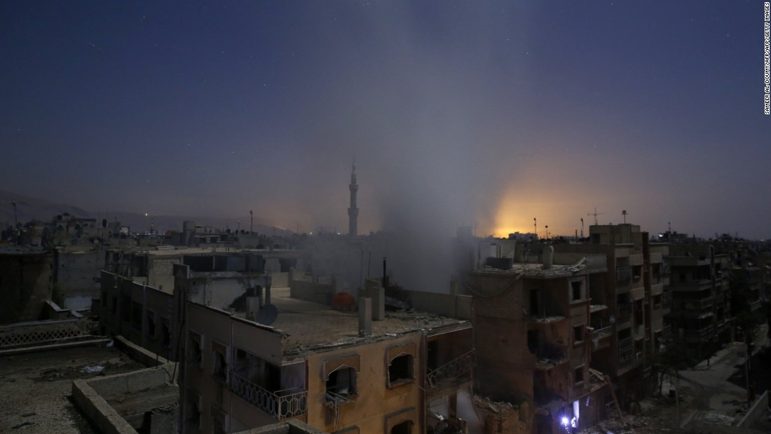 Smoke billows from a building in Douma, Syria, following reported shelling on Friday, October 30.