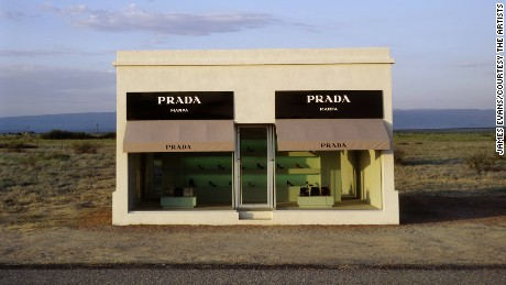 Elmgreen & Dragset Prada Marfa, 2005 Adobe bricks, plaster, aluminum frames, glass panes, MDF, paint, carpet, Prada shoes and bags 760 x 470 x 480 cm | 299 1/4 x 185 x 189 in photo by: James Evans