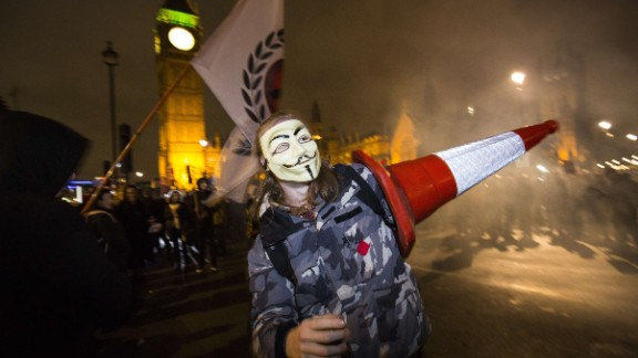 Protesters wear stylized masks of Guy Fawkes, one of the plotters of the failed Gunpowder Plot of 1605. The masks have been widely adopted by the Anonymous movement.