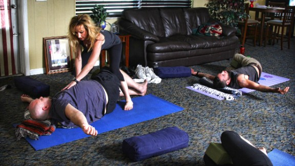 """Dana Santas, center, creator of Radius Yoga Conditioning, recently taught a yoga session at the Veterans Alternative Center in Holiday, Florida. The goal? To help """"reconnect their mind, body and spirit on the mat."""""""
