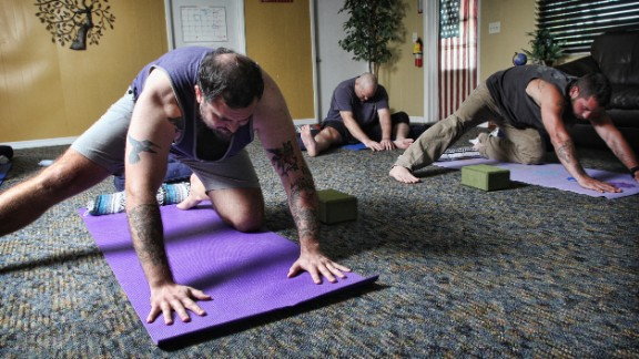 """""""By ... experiencing and controlling physical sensations and connecting breath and movement, participants maintain attention within their bodies and remain present on their mats, """" Santas said of practicing yoga postures."""
