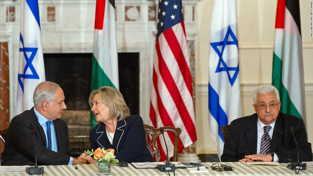 Clinton speaks with Netanyahu alongside Abbas as she hosts peace negotiations at the U.S. State Department on September 2, 2010.