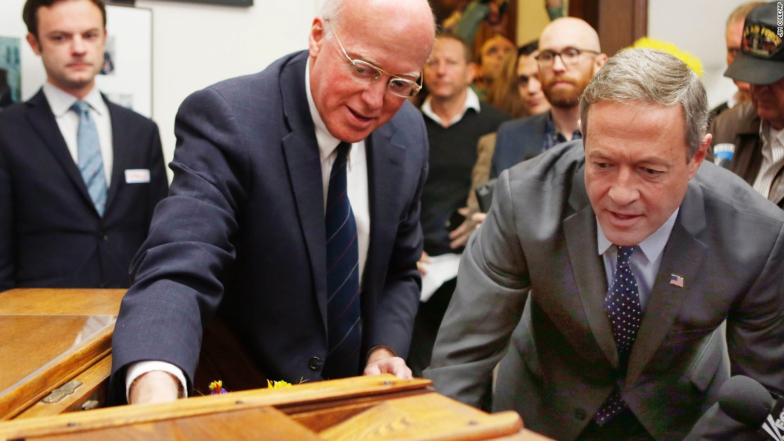 New Hampshire Secretary of State Bill Gardner, left, shows a historic ballot box to Democratic presidential candidate Martin O'Malley, who filed for the state's primary ballot on Wednesday, November 4.