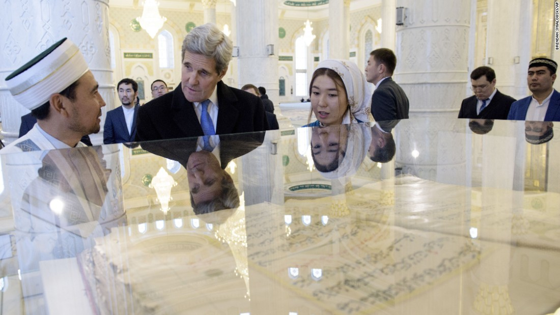 Chief Imam Serikbay Oraz, left, speaks to Secretary of State John Kerry about a Quran during a tour of a mosque in Astana, Kazakhstan, on Monday, November 2. Kerry was on the third leg of a five-nation tour of Central Asia.