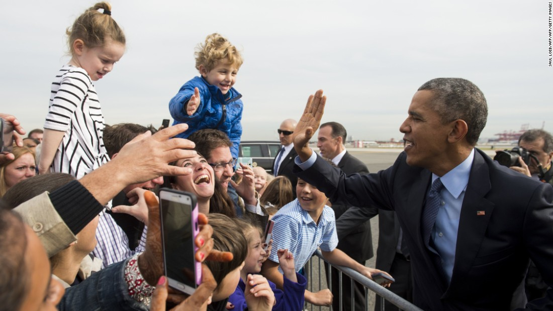 President Obama greets well-wishers after arriving at an airport in Newark, New Jersey, on Monday, November 2.