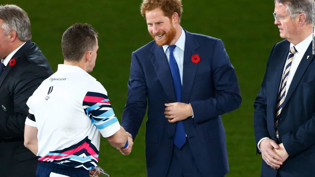 """I didn't want to be gay,"" Owens, seen here greeting Prince Harry before the Rugby World Cup final, told CNN. ""I actually went to the doctor at one stage to see if I could be chemically castrated in any way, if it would get rid of me being gay."""
