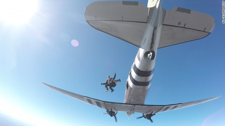 Chris Moody jumps out of an airplane with the all Veteran Group