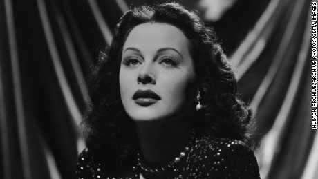 1943:  Austrian-born actor Hedy Lamarr (1913 - 2000), wearing a sequined gown, looks up in a promotional portrait for director Alexander Hall's film 'The Heavenly Body'.  (Photo by Hulton Archive/Getty Images)