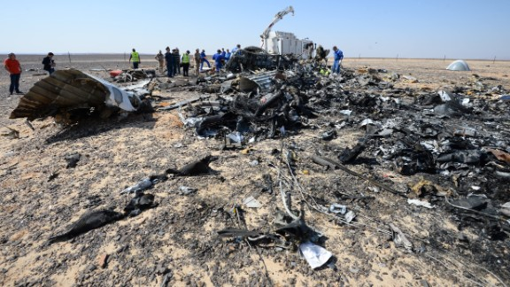 In this Russian Emergency Situations Ministry photo, made available on Monday, Nov. 2, 2015 Russian and Egyptian experts work at the crash site of a Russian passenger plane bound for St. Petersburg in Russia that crashed in Hassana, Egypt