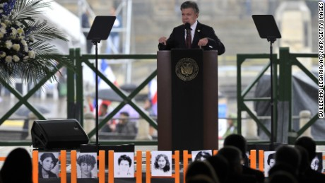 "Colombia's President Juan Manuel Santos delivers a speech during a ceremony to commemorate the 30th anniversary of the siege of the Palace of Justice by the M-19 guerrilla and its bloody recovery by the Army, at the Palace of Justice in Bogota, on November 6, 2015. Santos apologized in a ""public act of acknowledgment of international responsibility"" of the State for the disappearance of people during the bloody recovery by the Army, accepting a measure of reparation ordered last year by the Inter-American Court of Human Rights (IACHR).   AFP PHOTO / GUILLERMO LEGARIAGUILLERMO LEGARIA/AFP/Getty Images"