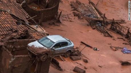 Dam break sweeps away homes in Brazil - CNN