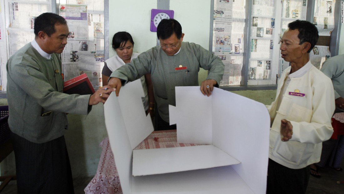 Tin Aye, chairman of Myanmar's Union Election Commission, inspects a polling station in Naypyidaw on November 7.