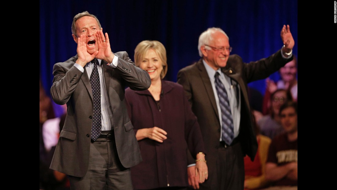 Democratic presidential candidate Martin O'Malley shouts to supporters as fellow candidates Hillary Clinton and U.S. Sen. Bernie Sanders wave at the crowd after a forum in Rock Hill, South Carolina, on Friday, November 6.