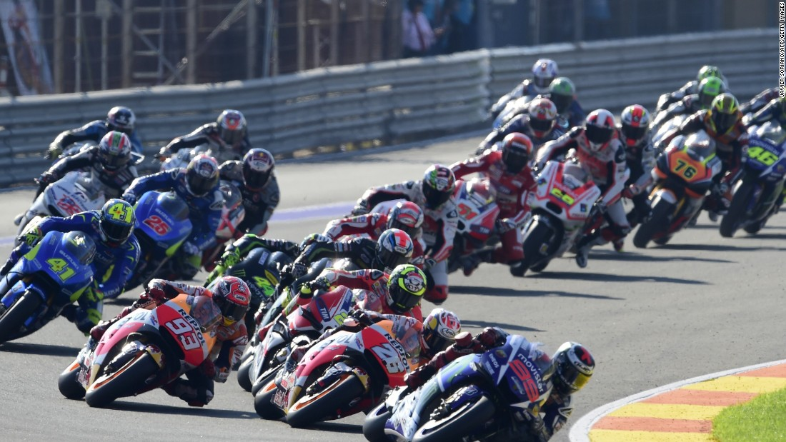 Lorenzo leads away from the start of the Valencia Grand Prix after taking first place on the grid. Rossi (no 46) can be seen towards the rear of the field.
