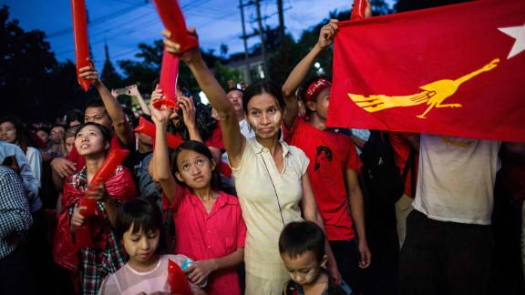 People rally outside the National League for Democracy office after Myanmar's first free and fair election in 25 years on November 8 in Yangon.
