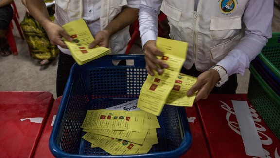 Votes are counted in a polling station in Yangon on November 8.