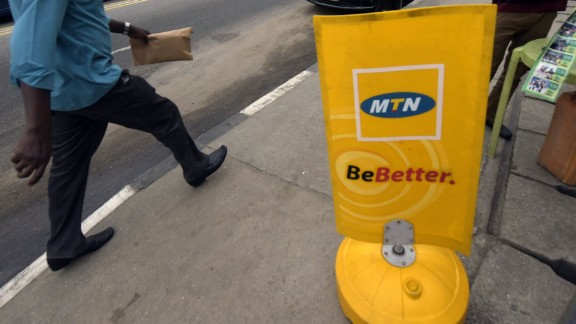 A man walks past a MTN notice board in Lagos, on October 27, 2015.  Nigeria
