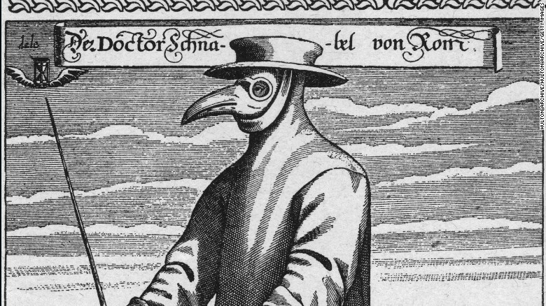 Circa 1656, a plague doctor in protective clothing.