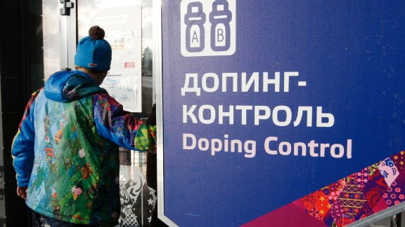 FILE - In this Feb. 21, 2014 file photo a man walks past a sign reading doping control, at the Laura biathlon and cross-country ski center, at the 2014 Winter Olympics in Krasnaya Polyana, Russia. In a devastatingly critical report, a World Anti-Doping Agency panel accused the Russian government on Monday of complicity in widespread doping and cover-ups by its track and field athletes and said they should all be banned from competition until the country cleans up its act. The report from a WADA commission that has been probing media allegations of widespread doping and deception in Russia said even the country's intelligence service, the FSB, was involved, spying on Moscow's anti-doping lab, including during last year's Winter Olympics in Sochi.  (AP Photo/Lee Jin-man, file)